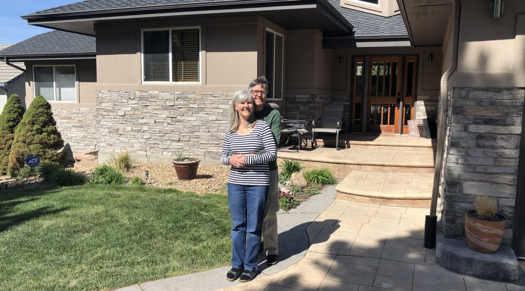 Nancy and Pete in front of their new house