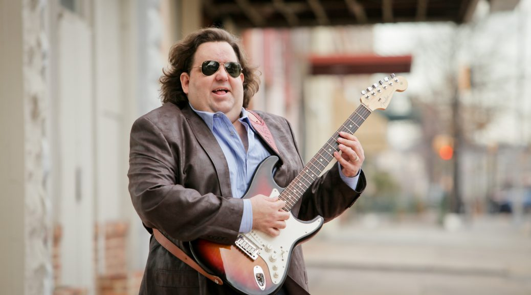 Joey Stuckey playing guitar