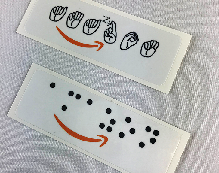 Amazon logo in Braille and ASL