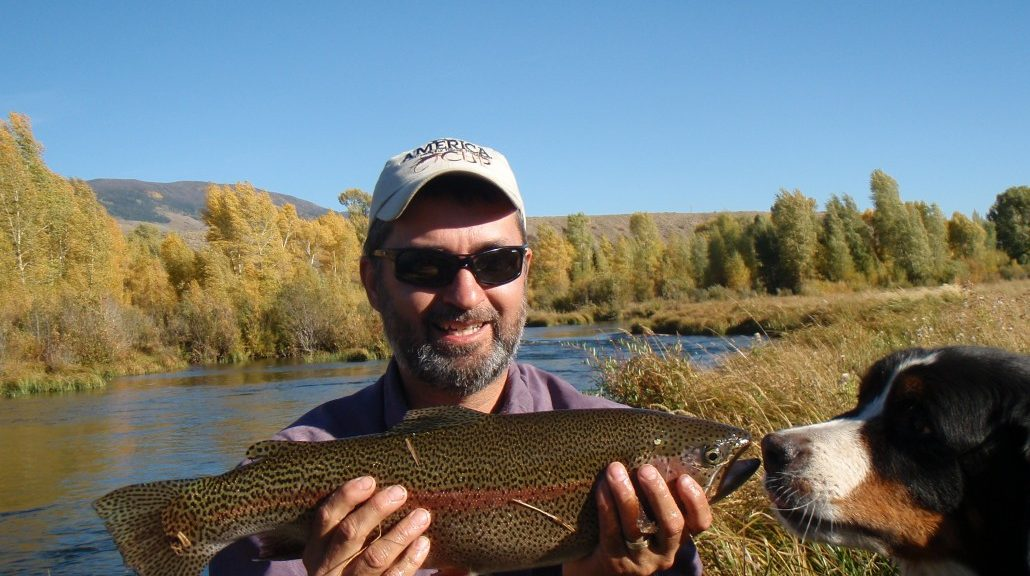 """lawrence with 24"""" trout and dog"""